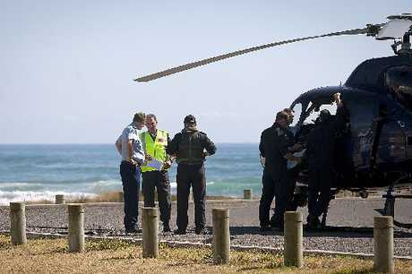 Police Sergeant Warren Shaw (in florescent vest) speaks with the Police helicopter crew. Photo / Andrew Warner