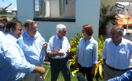 Member for Burnett Stephen Bennett, Member for Hinkler Paul Neville, Division 5 councillor Danny Rowleson, Prime Minister Julia Gillard and Federal Treasurer Wayne Swan survey the damage of a home that had its roof blown off in the Burnett Heads tornadoes last month.