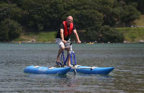 Greg Gibb, Akwakat co-partner, tests the water-bike kit on Pilot Bay.