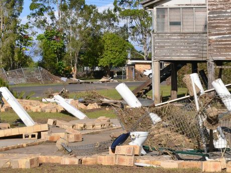 FLOOD DAMAGE: The flood water swept one home away whilst its neighbour remains on Thornhill st North Bundaberg. Photo: Scottie Simmonds / NewsMail
