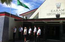 Karamu High School principal Martin O&#39;Grady and students lowered the school flag this morning in honour of Sir Paul Holmes. Picture/Amy Shanks