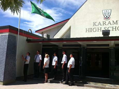 Karamu High School principal Martin O'Grady and students lowered the school flag this morning in honour of Sir Paul Holmes. Picture/Amy Shanks