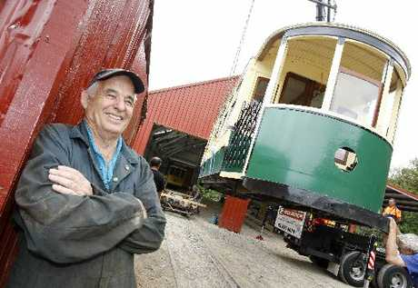 GRINNER: Whangarei Steam and Model Railway Club treasurer Ray Palmer is all smiles after taking delivery of two electric trams at the Whangarei Museum and Heritage Park grounds in Maunu.