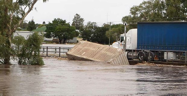 McCahon Bridge, Victoria St in Warwick was completely under water on Monday.