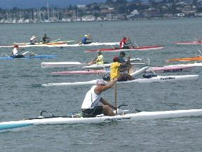 The outriggers head off at the start of last year's James Moore Memorial outrigger canoe race.