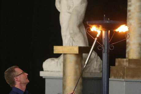 LIGHT IT UP: Games manager Mike Cronin lights the torch to open the 2013 NZ Masters Games.