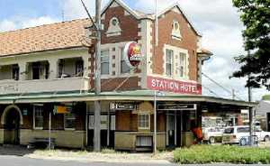 The Station Hotel in South Lismore and, above, a CCTV still of the Banora Point armed robbery.