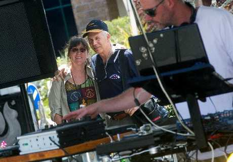IN TUNE: Tourists Sue and Jim Villamagna stop to enjoy the reggae sounds of Roots - Dub - Reggae served up to Eat Streat diners yesterday by DJ Ernest Moore (right).