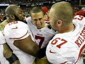 GAME ON: San Francisco 49ers' Colin Kaepernick (7) celebrates with Leonard Davis and Daniel Kilgore (67) after advancing to to Superbowl XLVII.