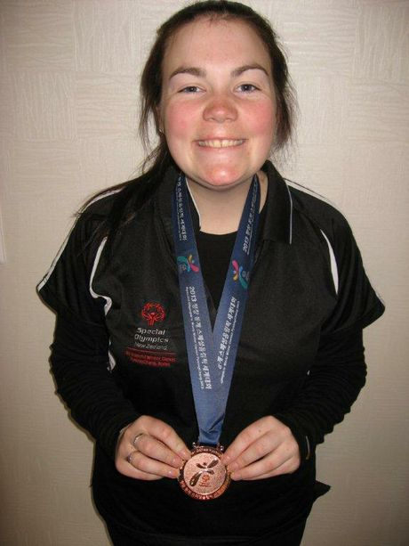 PROUD: Brittney McKenzie shows off her bronze medal from the Special Olympics World Winter Games in South Korea. PHOTO/SUPPLIED