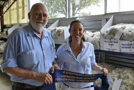 TOP FLEECE: Colin Chapman and Sarah McMeniman with the champion restricted fleece at Stanthorpe Show. The fleece was entered by Geoff and Andrea Fearby, Texas.