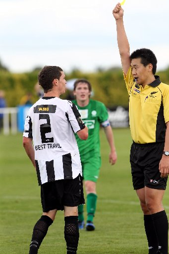 DEJA VU: Last summer referee Mirko Benischke showed Fergus Neil a yellow card but yesterday he saw red.