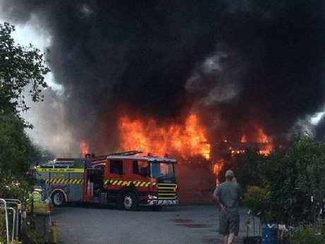 THREAT: A neighbouring house and vehicles were also threatened in the blaze at the GardenBarn site in Masterton yesterday.