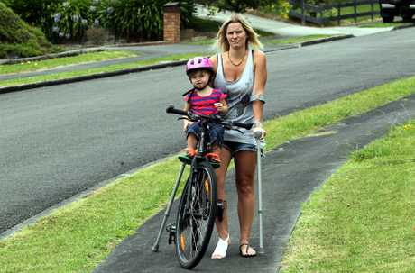 TWICE BITTEN: Angela Munro, with 22-month-old Jaime, was cycling down Parkdale Drive on Friday afternoon when a dog bolted from behind a fenced property and bit her on the leg.PHOTO/STUART MUNRO 040213WCSMDOGATTACK1