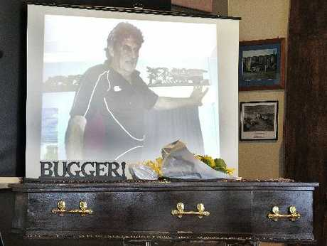 "LARGER THAN LIFE: The funeral of Richard Spraggs, who died in a boating accident in Thailand was a colourful affair. Mr Spraggs' coffin was adorned with flowers, sand and the word ""bugger!"" to reflect his outgoing, ocean-loving nature."