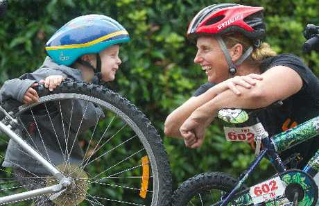 BIKE SWAP: Steff Kidd is using a bike to get to her Porse carers next week instead of driving. Pictured with her son Max, 3.