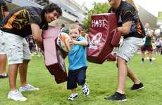 NRL Indigenous All Star's Captain Johnathan Thurston with young rugby player Ash Wilson, 5, at a junior clinic in the Ipswich Mall on Monday evening. Photo: Claudia Baxter / The Queensland Times