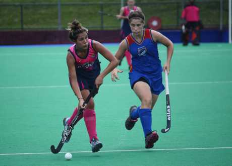 Toowoomba's Amber Mutch (left) will play for the Queensland Rubies indigenous hockey team.