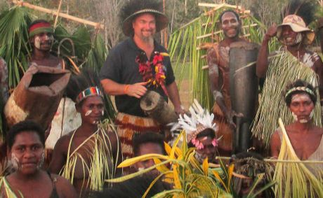 FRIEND INDEED: Craig 'Crackers' Hand with the remote tribe in Papua New Guinea. Photo: Contributed