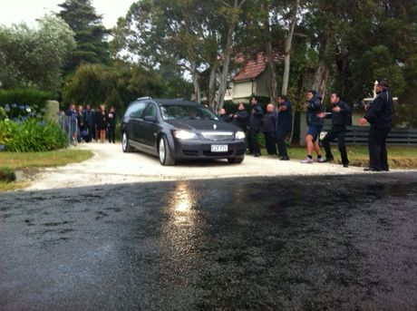 A hearse leaves Mana Estate flanked by family, as local Maori perform a haka. Photo: Paul Taylor.