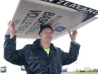 GIMME SHELTER: Mark Wilson improvises to keep the rain at bay on day four of the games yesterday.