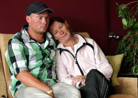HEARTBROKEN: Jill Lewis and son Rob are grieving at the theft of their stallion, Deacon, and the destruction of other animals on their Waverley farm.