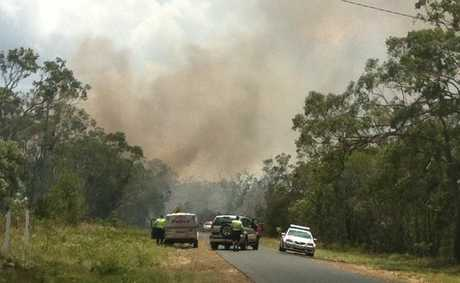 Police and other emergency services are at the scene of a bushfire at Pacific Haven near Howard.