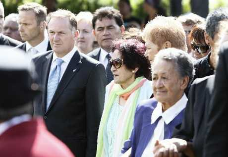 Prime Minister John Key, kuia Titewhai Harawira, Naida Glavish (partly obscured), and Ani Taurua make their way on to Te Tii Marae. Photo / Michael Cunningham