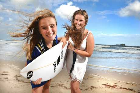 Jazzy Stokes and Savannah Burke from Mudjimba get the surfborad ready for the big day.