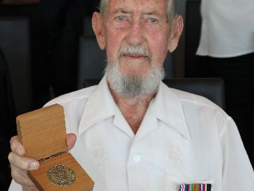 Bill Flower pictured with recently awarded University of Waikato medal.