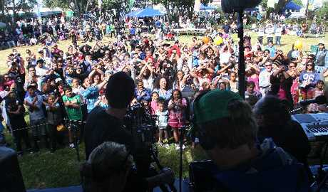 X-CITED: The crowd at PaePae in the Park help a film crew out with a promo for television series X-Factor. PHOTOS/ BEVAN CONLEY