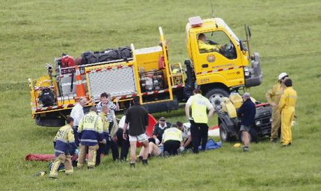 Emergency service personnel attend to a quad bike accident on a Maungakaramea farm in 2011 where the farmer was trapped for 45 minutes.