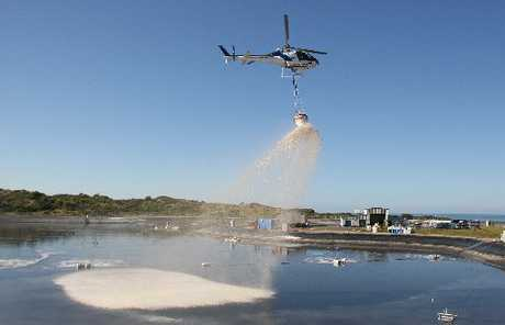 DOSING UP: A Ravensdown Aerowork helicopter drops another 14 tonnes of lime slurry on to the city&#39;s wastewater treatment ponds yesterday as the battle to beat the stench coming from the plant continues.