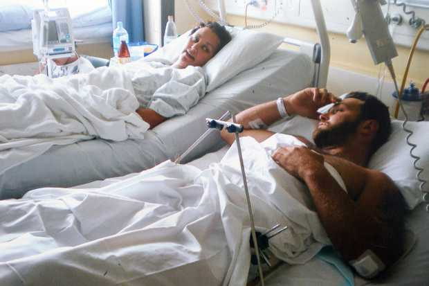 INJURED: Louise Maki (left) and her partner, David Storey, in hospital in 2009 after the crash.