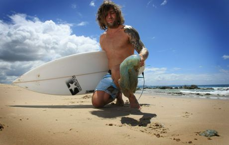 Surfer Bo Carter with one of the blue jelly fish causing the problems.