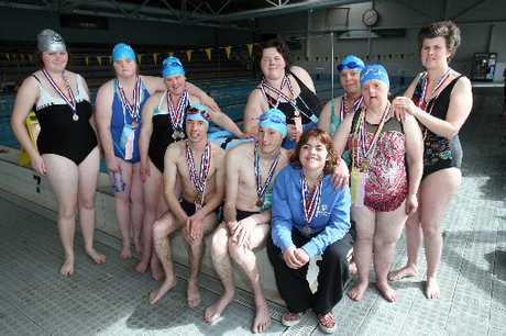 OLYMPICS-BOUND: Members of the Wai Toa Special Olympics Wairarapa Swim Team wearing their medals from the Levin Aquatics Regional Event in September 2012. Standing, Caroline Walsh (left), Jayne Bruce, Kate Bruce, Nicole Taylor, Rosie Lacey, Karen Johns and Samarah McKinnon. Front seated Daniel Simonsen (left), Caleb MacNamara and Amy van Wijk.