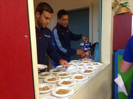 HEALTHY START: James Parsons and Jackson Willison of The Blues serving up Weet-Bix at Te Kura O Otangarei.