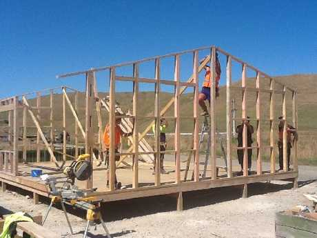GOING UP: AG Challenge pre-trades training students help assemble another relocatable house at the company's No 3 Line site. Now, having won a Government tender, AG Challenge will be taking on 50 new students this year and increasing its number of tutors. PHOTO/SUPPLIED