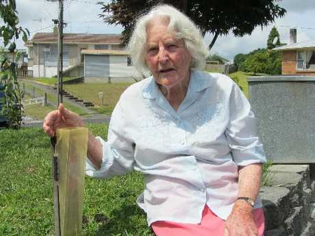 Margaret Vant with her rain gauge on her front lawn in Te Puke.