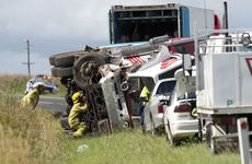 Emergency services attend the scene of a truck and ute crash at Greenmount.