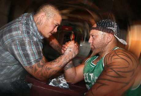 CHAMPS: Rotorua arm wrestlers Maateiwarangi Heta-Morris (left) and Monty Corbett train in their beloved sport.