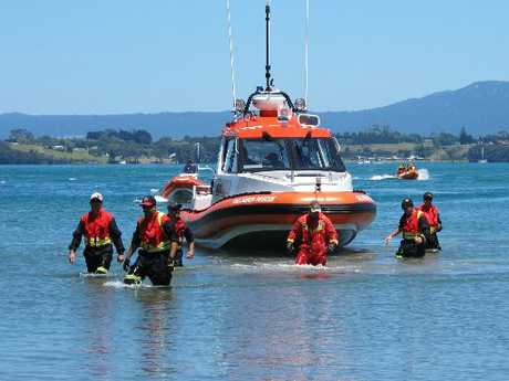 Members of Newmont's Mines Rescue Unit search the water at Anzac Bay looking for Tim Mair.