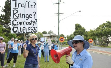 Friends of the Toowoomba Range spokeswoman Kate Powell leads more than 100 demonstrators opposing the development of Eastside Village.