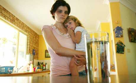 Liz Lovelock believes tap water is responsible for the rashes over her daughter Amelia's body.