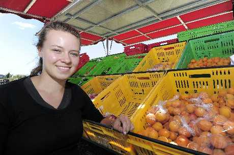 Laura Bauer mans the fruit truck on Maranui St in Arataki