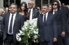 Sir Paul&#39;s casket was carried out by pallbearers (from left) Mike Williams, Millie Elder-Holmes, Peter Beavan, Ken Holmes, Rueben Holmes and Paul Watkinson. 