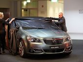 HOLDEN posted a net loss after tax of $152.8 million last year due to increasing competition and a high Australian dollar.