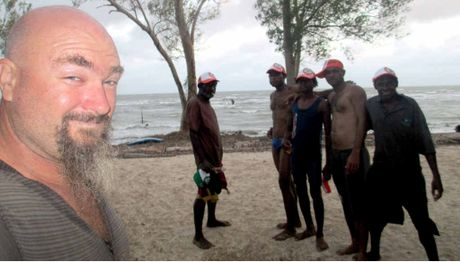 SAFE: Craig Hand with some friendly PNG villagers prior to his run-in with pirates.