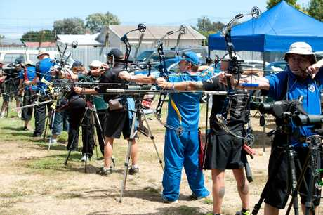 ARCHERS READY: Archers prepare to loose their arrows at Saturday's Masters Games archery competition held at Wembley Park. PHOTO/RAE CLIFFE 090213WCRCARCHERY01
