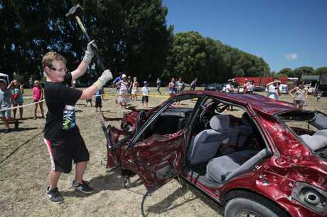 Caleb Wadsworth smashes a car with a sledge hammer at the 107th annual Te Puke A&amp;P; Show. 